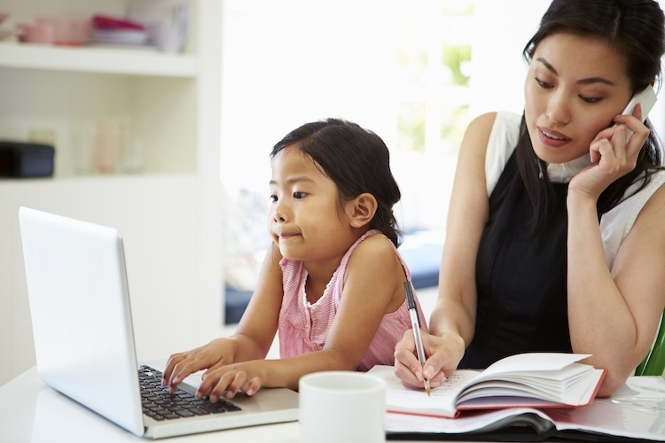 Mom Working From Home With Toddler