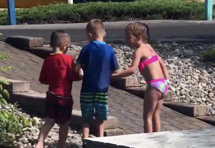 kids help friend with cerebral palsy