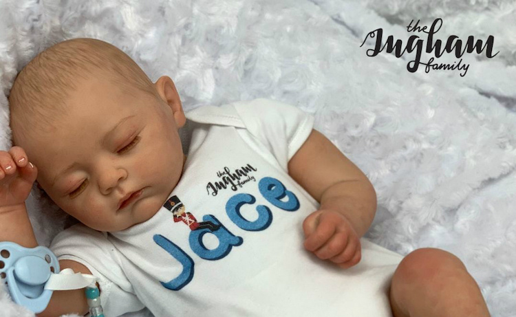 the ingham family selling replicas of newborn baby jace