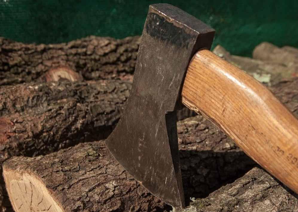 an axe stuck in wood