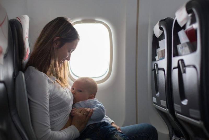 Mom breastfeeding baby on plane
