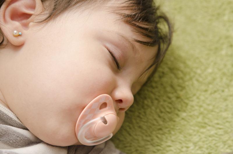 baby gets ears pierced