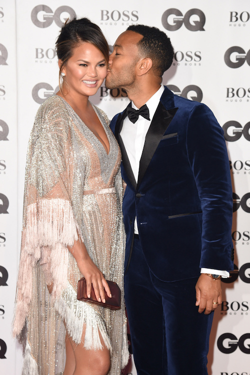 chrissy teigen and john legend proving parents and pda can still go together.