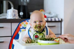 My Baby Just Started Eating Solids & It's Changed Her Poop. Is This Normal?