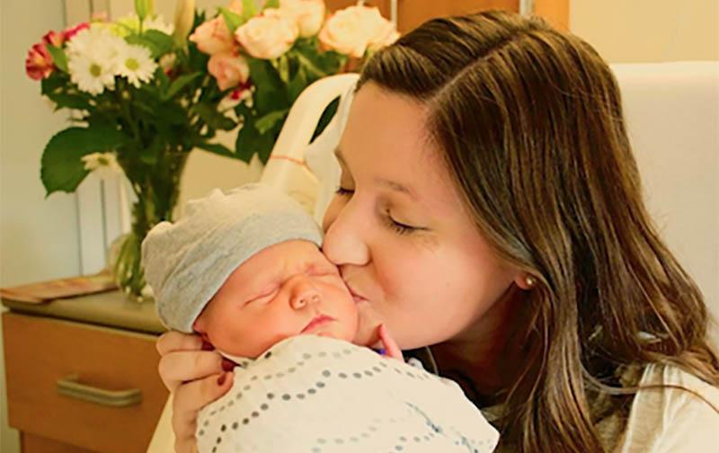 Tori Roloff kissing Baby Lilah Ray