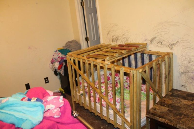 mom, grandparents charged with child neglect after locking children in wooden 'crib-cages'