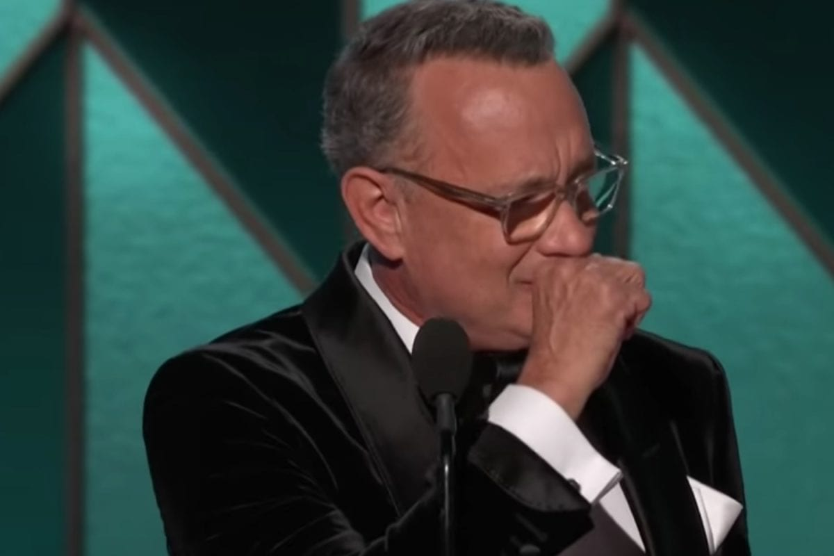 actor tom hanks plays his best role, dotting dad and husband, while accepting prominent golden globe award | tom hanks cries while accept prestigious award at the golden globes.