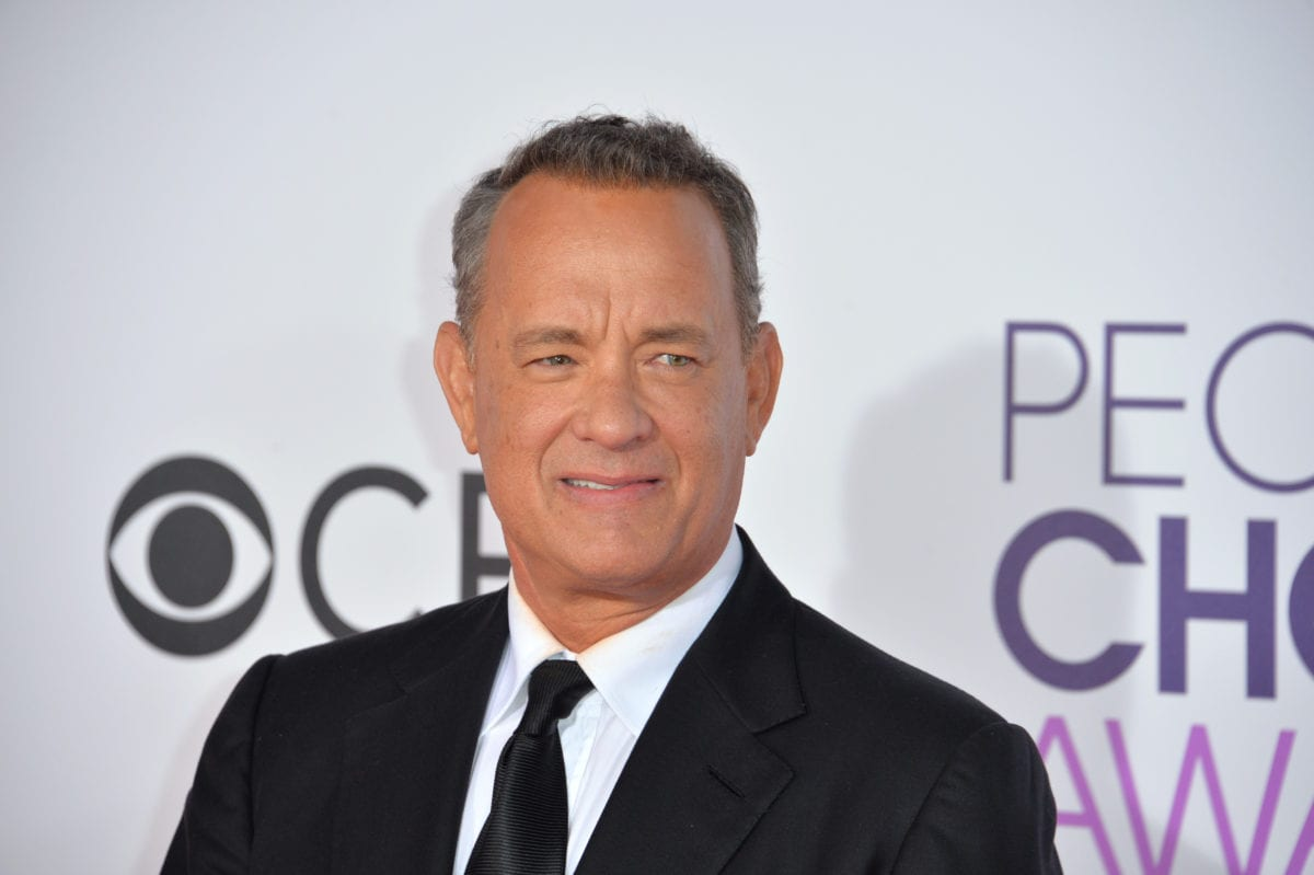 Actor Tom Hanks Plays His Best Role, Dotting Dad and Husband, While Accepting Prominent Golden Globe Award