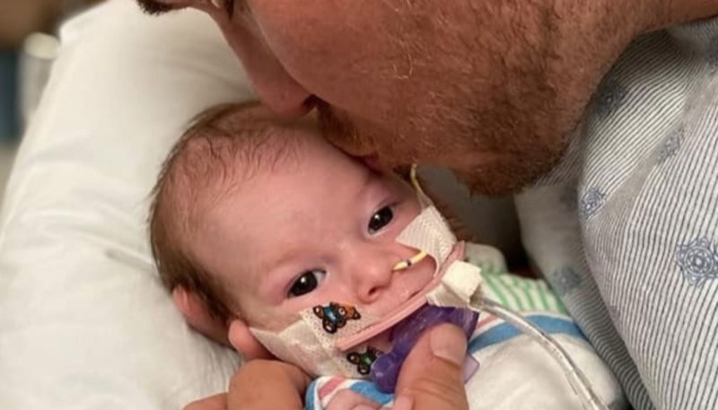 """video shows family ringing the bell that signifies the end of cancer treatment after a 5-month-old becomes a cancer survivor   lillian """"lily"""" grace is just five months old and has already overcome brain cancer."""