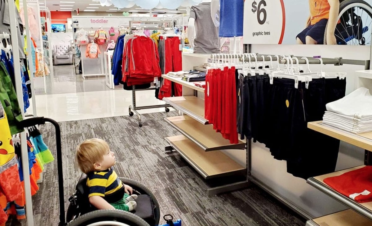 photo of toddler in wheelchair looking at target ad that looks like him in 'awe' goes viral