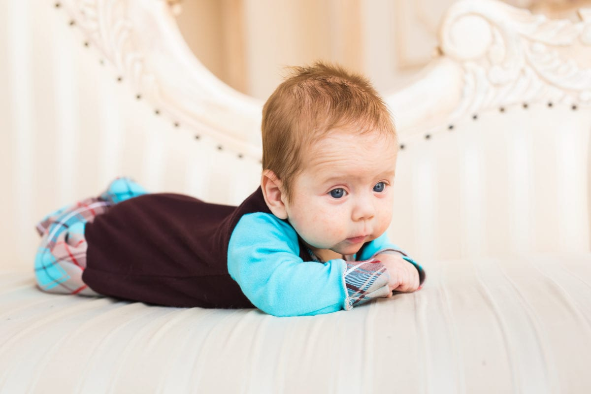 Adorable baby boy with red hair and blue eyes. Newborn child lying in couch. 30 Irish-Inspired Baby Names for Boys and Girls