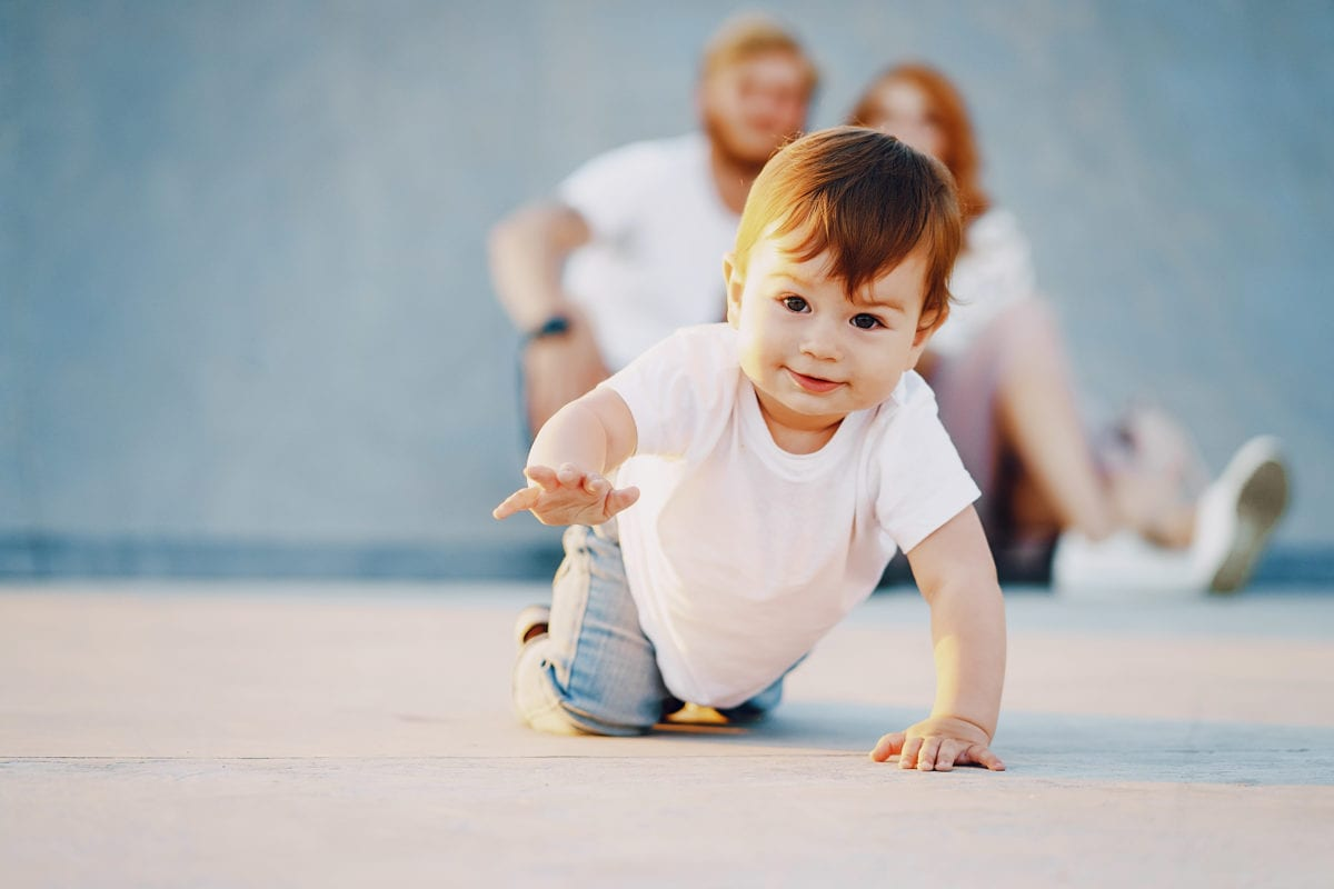 Red haired boy crawling 30 Irish-Inspired Baby Names for Boys and Girls