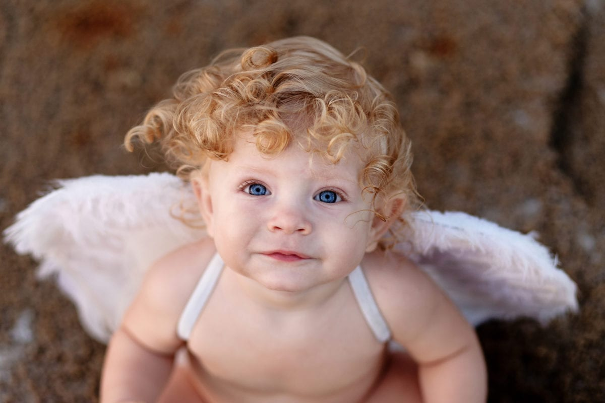 Curly haired boy with angel wings 30 Irish-Inspired Baby Names for Boys and Girls