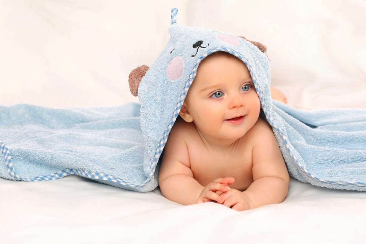 Boy with bath towel 30 Irish-Inspired Baby Names for Boys and Girls
