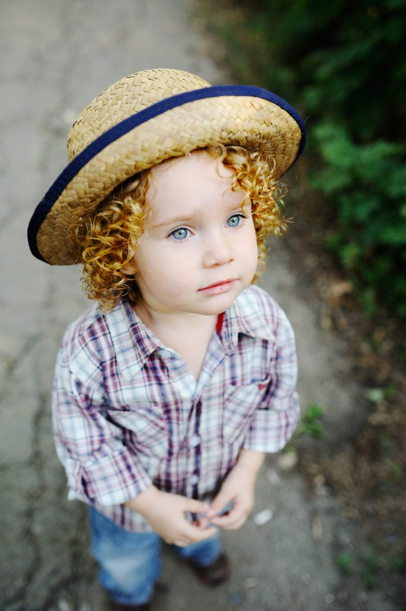 Cute curly haired girl in hat 30 Irish-Inspired Baby Names for Boys and Girls