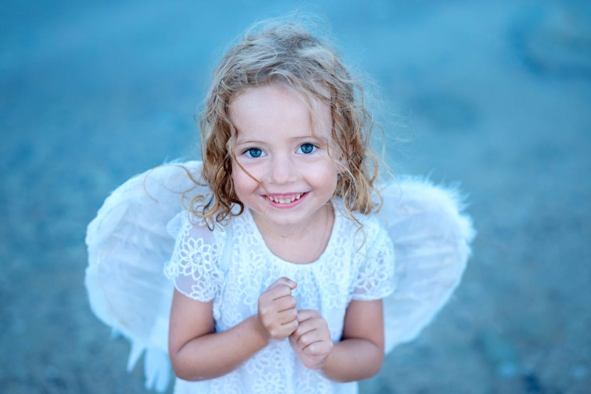 Smiling girl with angel wings 30 Irish-Inspired Baby Names for Boys and Girls