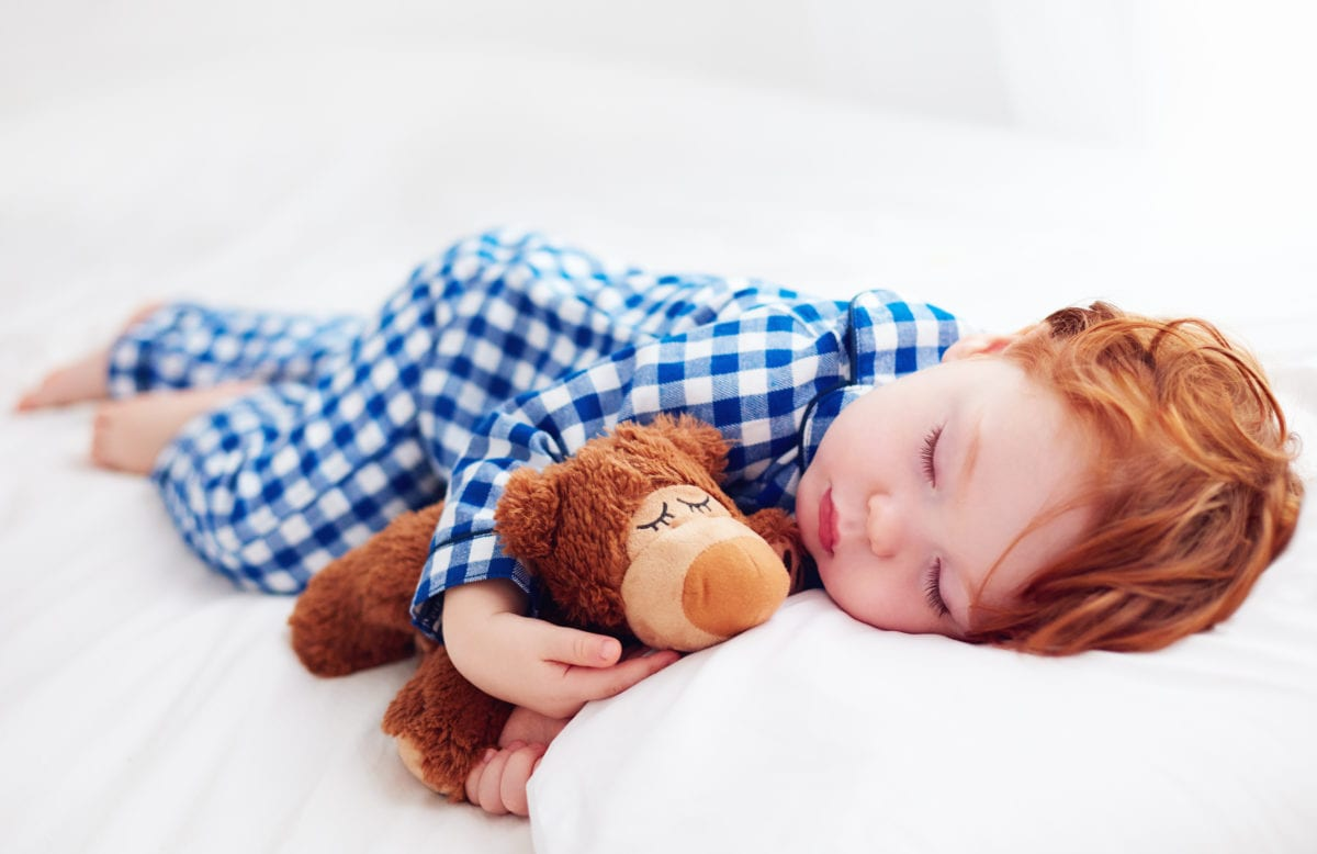 Red haired boy sleeping 30 Irish-Inspired Baby Names for Boys and Girls