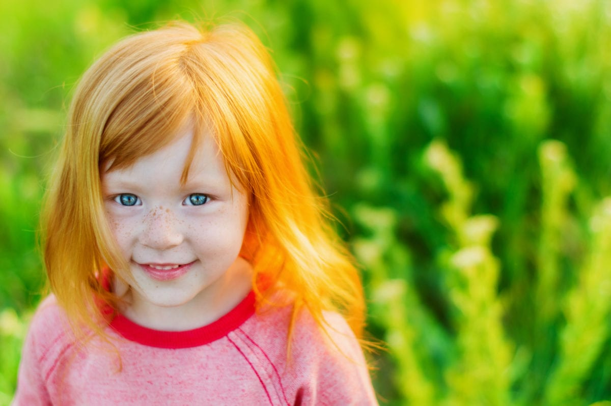 Red haired blue eyed girl in field 30 Irish-Inspired Baby Names for Boys and Girls
