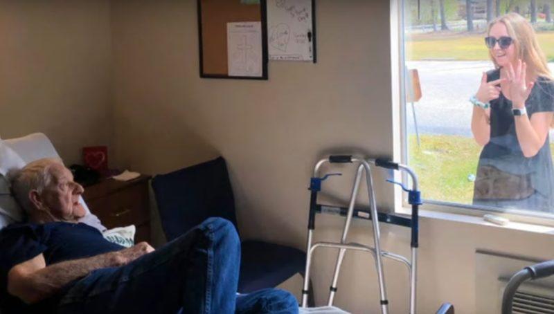 newly engaged woman surprises grandpa in quarantine through nursing home window