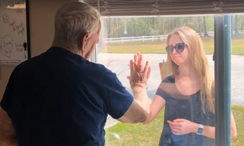 Newly Engaged Woman Surprises Grandpa In Quarantine Through Nursing Home Window