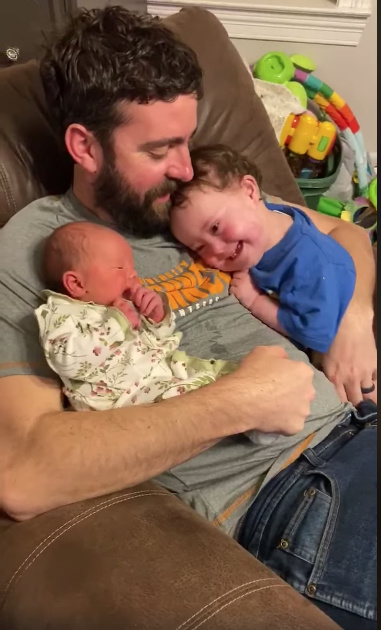 a 1-year-old boy with down syndrome enamored with newborn sister is the best thing you'll see today