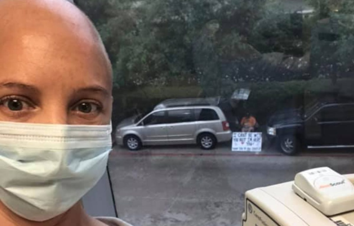 Husband Who Can't Be With His Wife During Her Cancer Treatments Shows Up Outside Her Window to Support Her and the Staff with a Sign