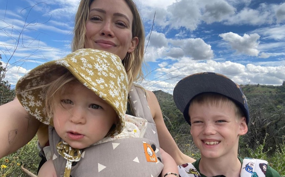mom of 2 hilary duff is doing whatever she can to keep her little ones busy, even letting her 8-year-old son do her makeup
