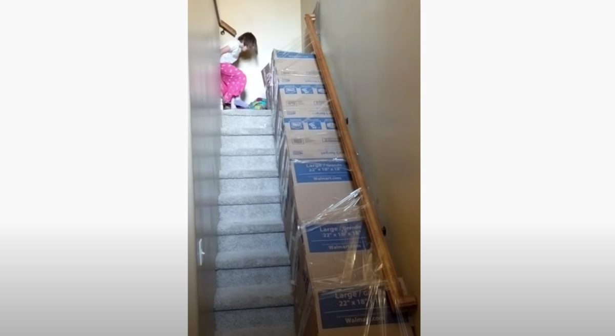 dad creates quarantine slide in home for kids... you just need boxes and tape