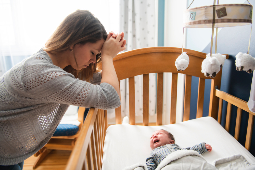 my 8-month-old baby still wakes up three times a night and i'm struggling: is this normal?