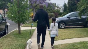Black Dad Shares Why He's Never Walked Through His Own Neighborhood Without His Dog or His Daughter By His Side