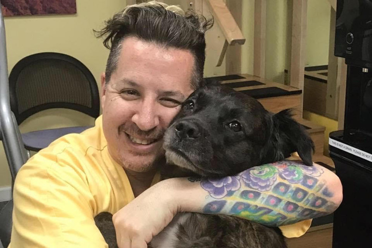 Dr. Noah Greenspan and his dog promoting the Pulmonary Wellness Foundation's free Covid-19 Rehabilitation Bootcamp