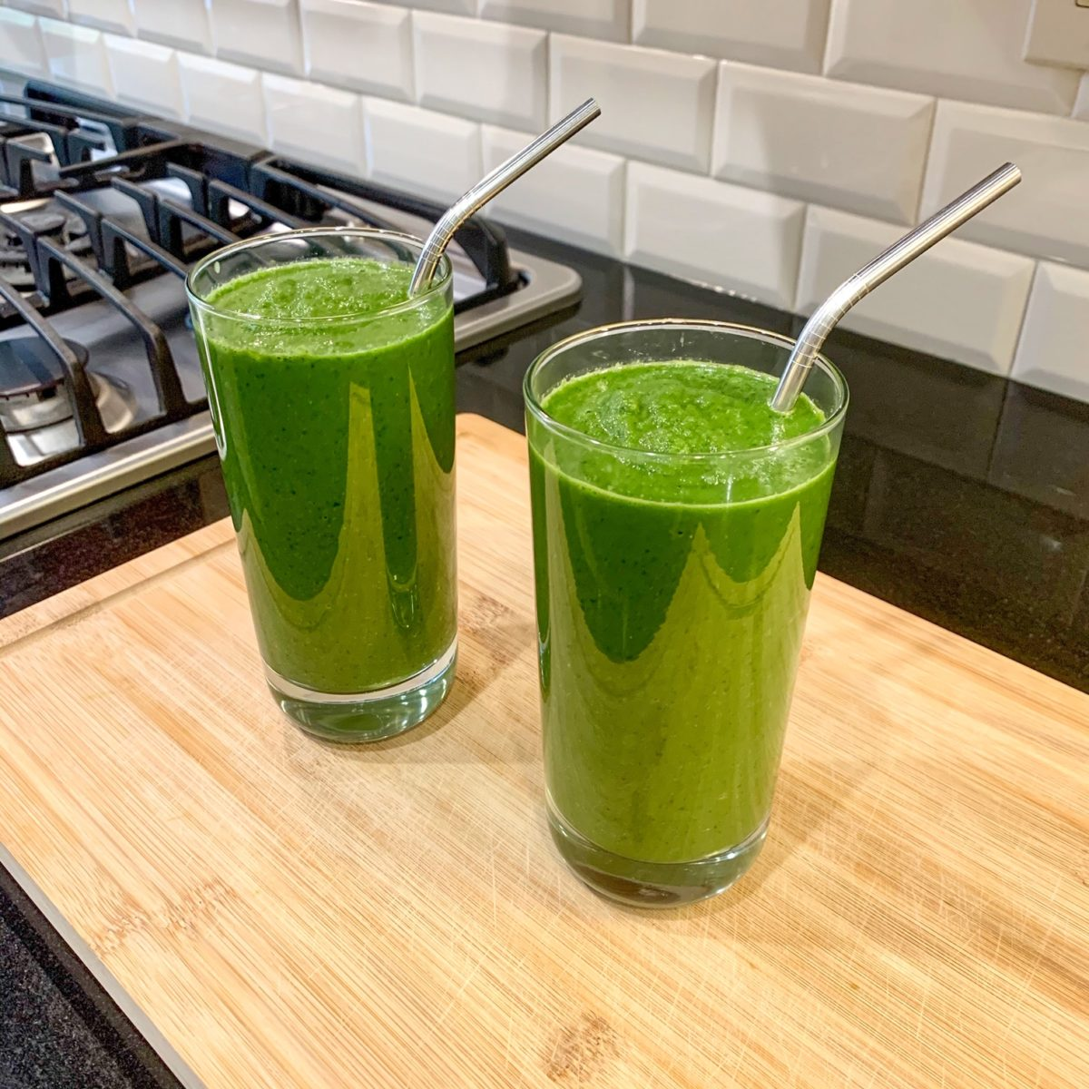 the healthy green smoothie reese witherspoon drinks every day in glasses with straws