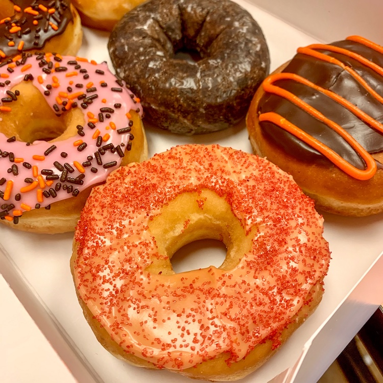 dunkin' has a spicy ghost pepper donut and a halloween diy decorating kit with orange frosting and various sprinkles