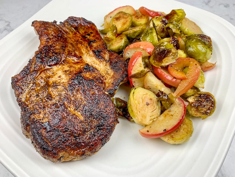 Ayesha Curry's Easy Pork Chops with Apples and Brussels Sprouts Finished Dish on a plate