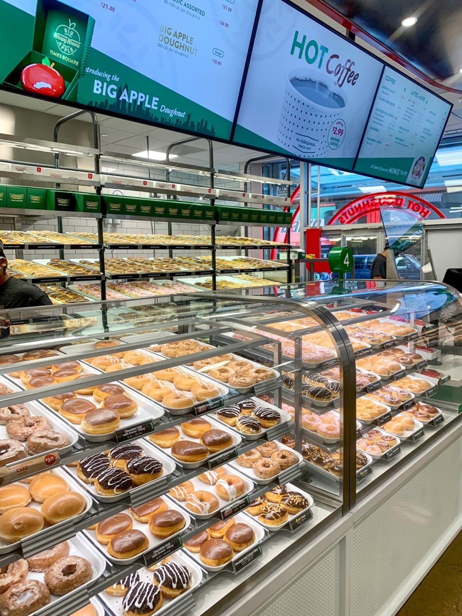 Krispy Kreme Times Square Display Case with a Variety of Doughnuts