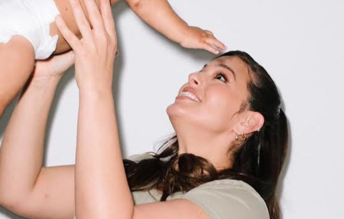 model ashley graham continues to normalize breastfeeding by sharing a photo of her son feeding while standing
