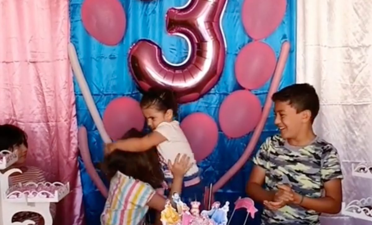 Aunt Says That's Just How Sisters Are After Video of Little Sister Beating Up Her Older Sister for Blowing Out Her Birthday Candles Goes Viral