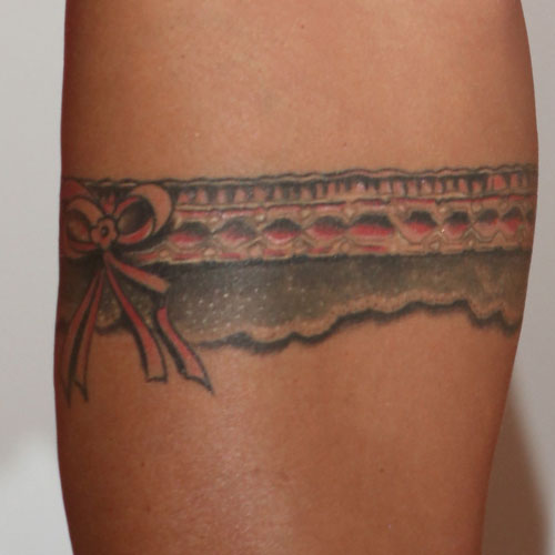 3. katie price - garter tattoo