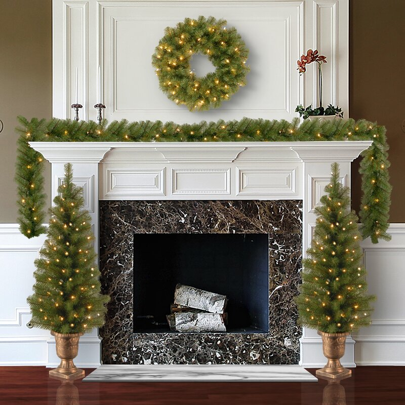 40 christmas decorations that will leave you and anyone else who enters your home with much holiday cheer   parenting questions   mamas uncut 4piecechristmasdecorating427greenartificialchristmastreesetwith50clearlights