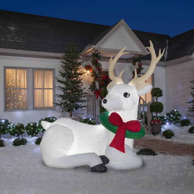 40 christmas decorations that will leave you and anyone else who enters your home with much holiday cheer   parenting questions   mamas uncut gemmyrestingbuckinflatable