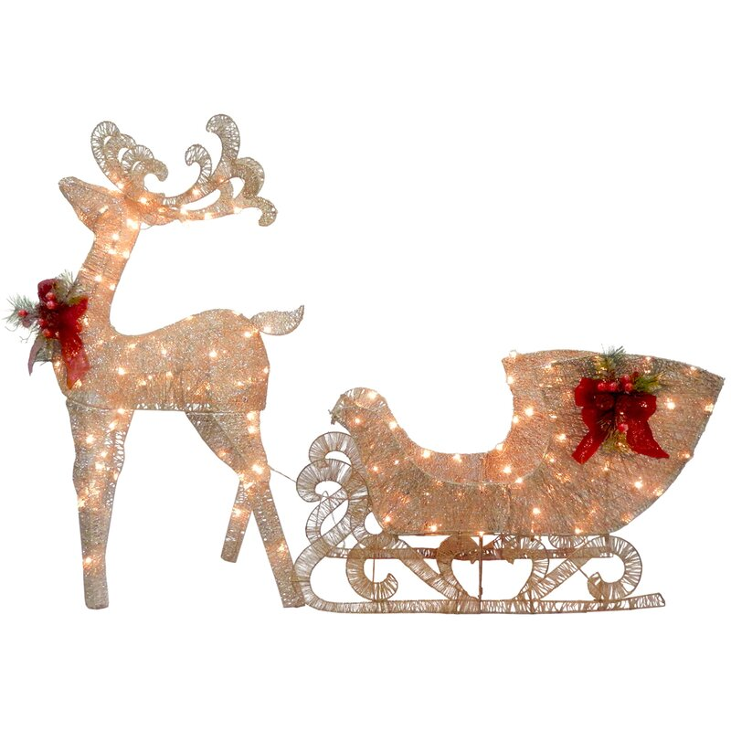 40 christmas decorations that will leave you and anyone else who enters your home with much holiday cheer   parenting questions   mamas uncut reindeerpullingsleighlighteddisplay