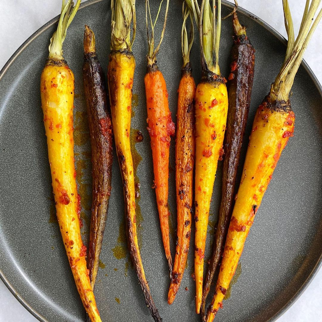 10 modern thanksgiving sides certain to refresh your holiday dinner roasted heirloom carrots with harissa