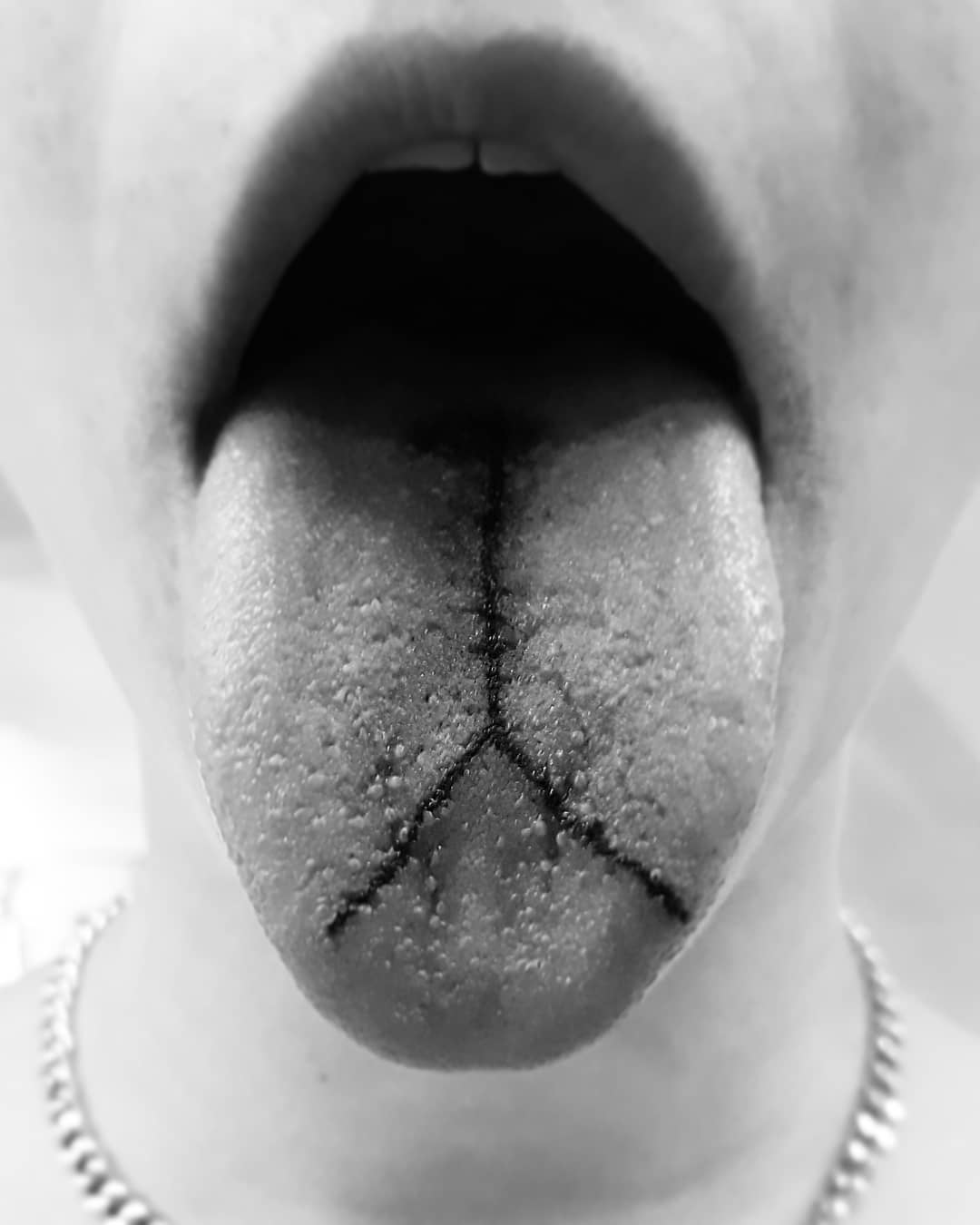 25 real tongue tattoos that we don't have a taste for