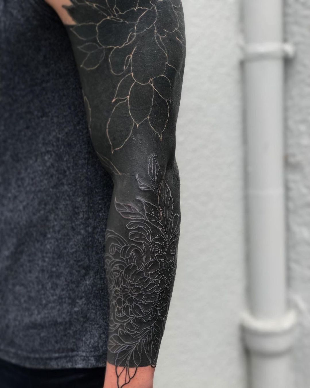 25 blackout tattoos with white ink for the perfect black and white look