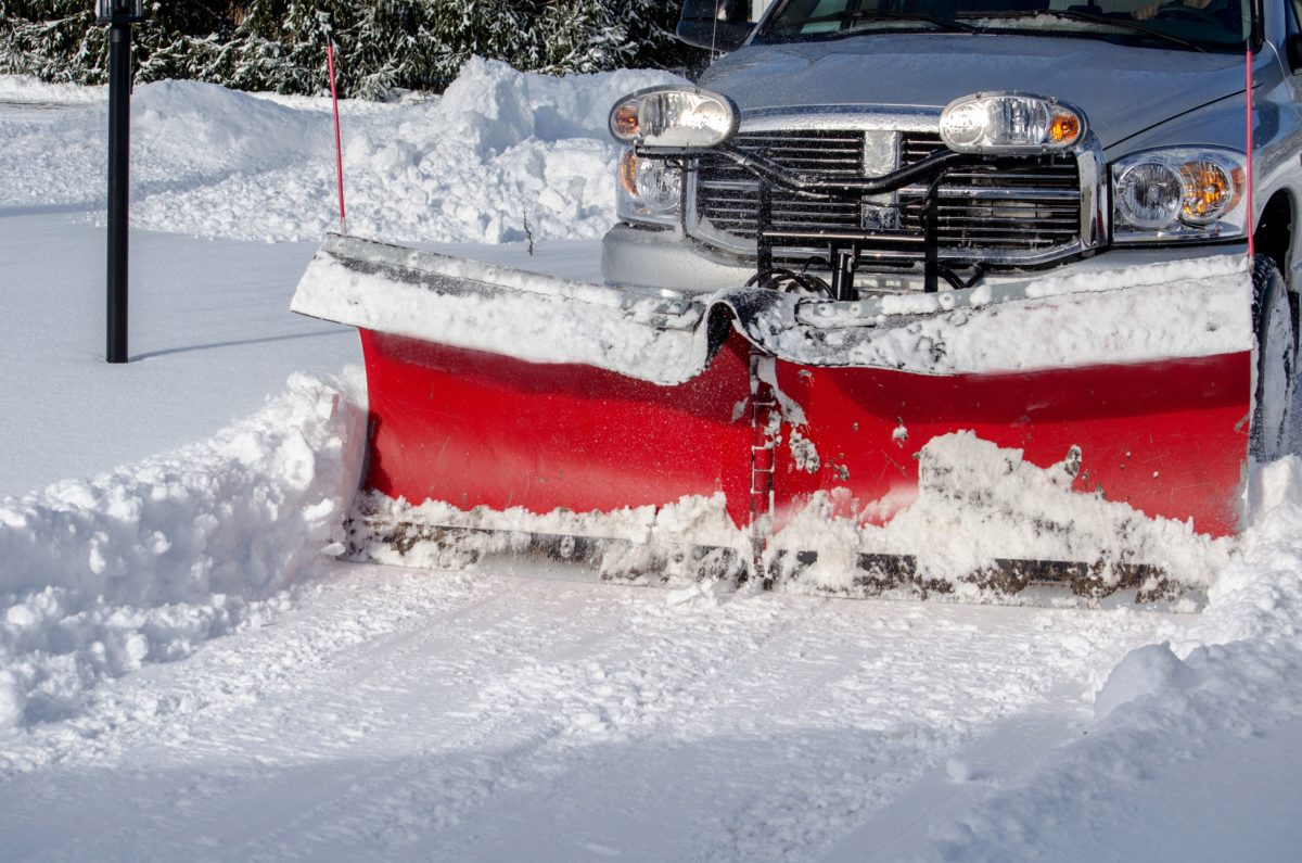 child buried by snowplow while playing outside hospitalized