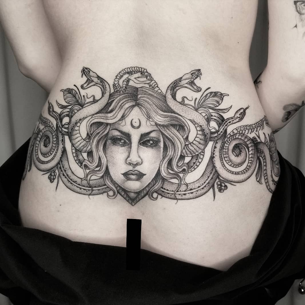25 lower back tattoos that upset taboo and reclaim a fabulous look