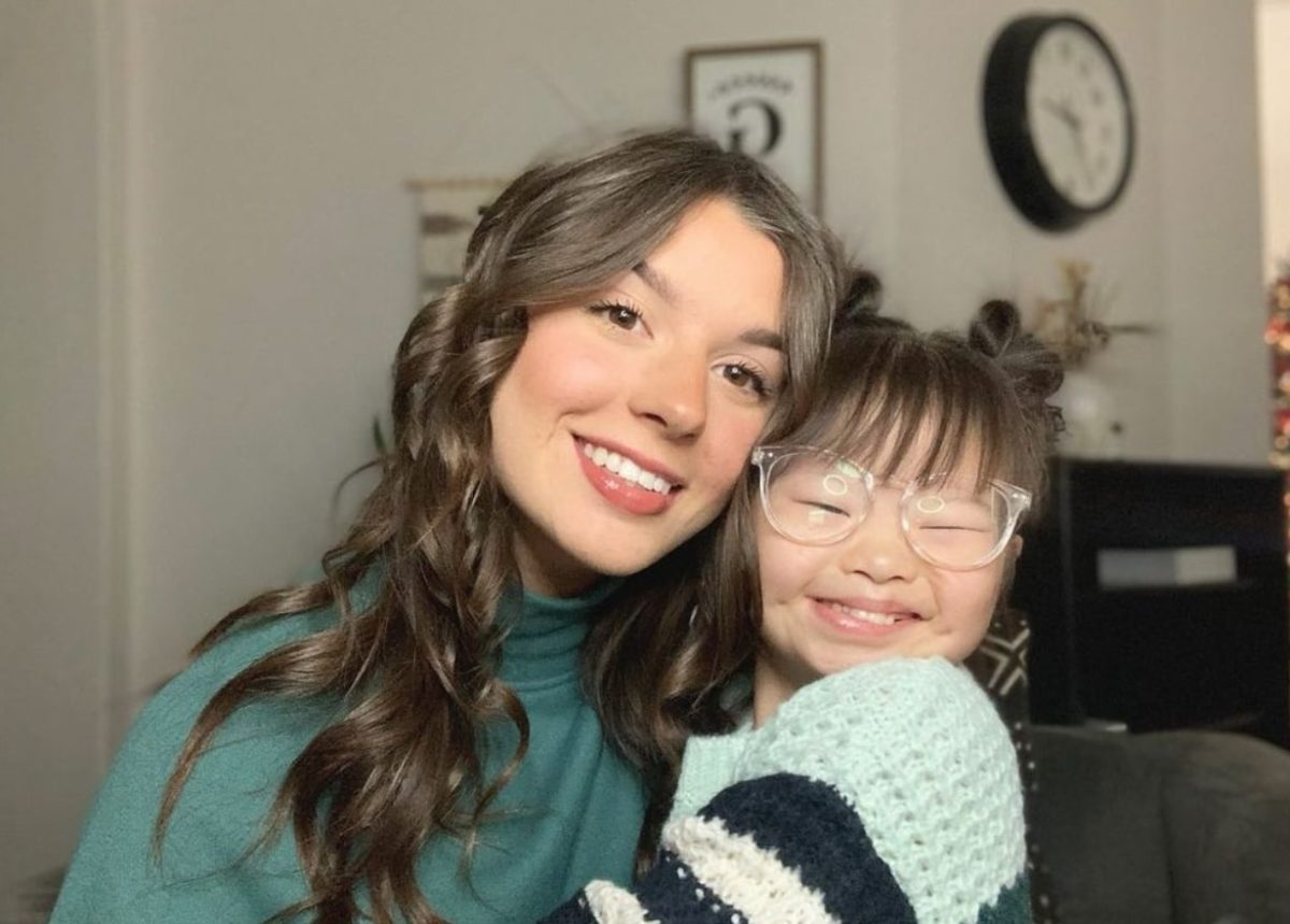 Girl With Down Syndrome Goes Viral For Styling Sister's Hair