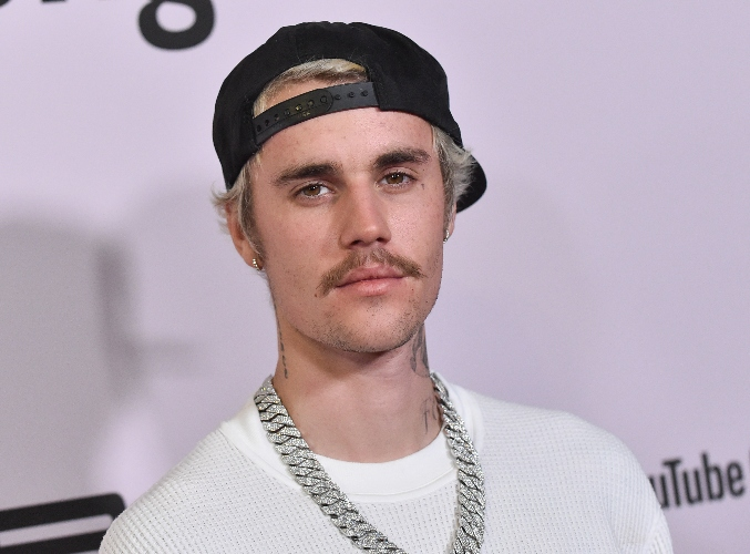 justin bieber's mom reacts to his new peach neck tattoo