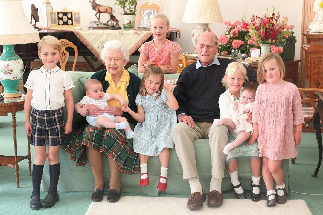 we love this never-before-seen photo of the queen, the late prince philip, and their great-grandchildren