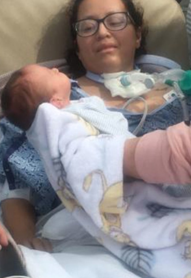 woman who gives birth in a coma holds baby for the 1st time